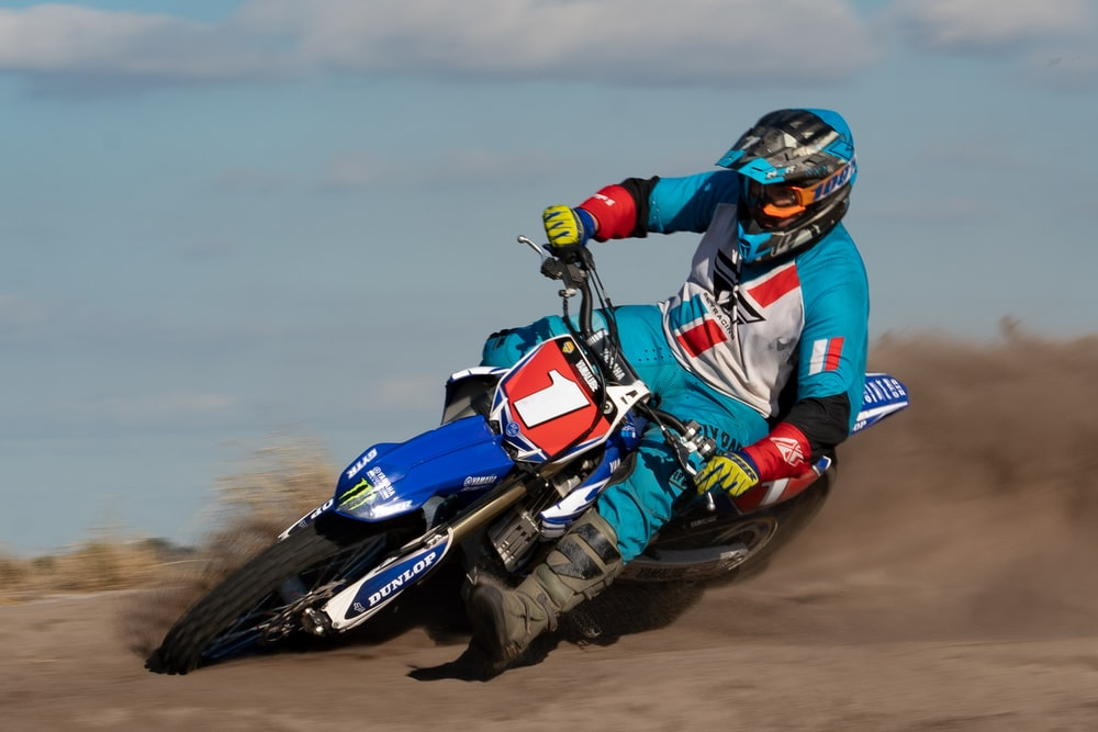 person riding on dirt bike close-up photography
