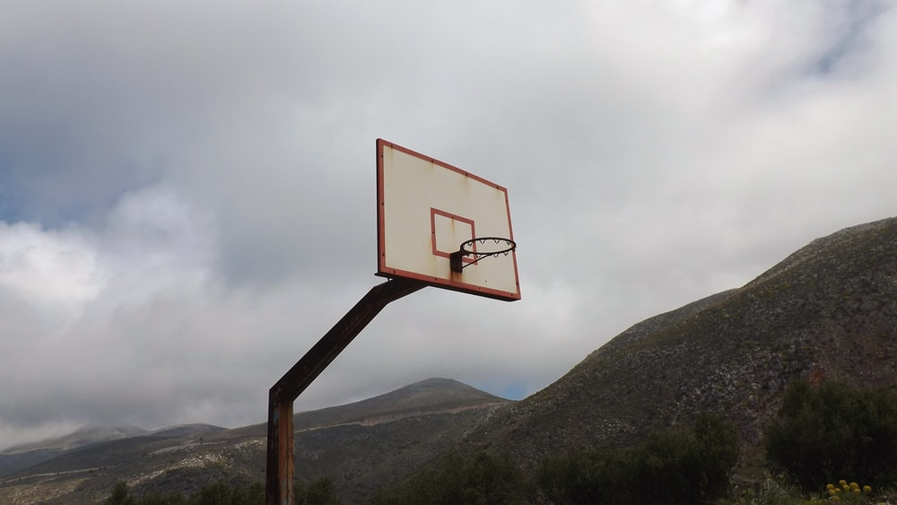 white and orange basketball hoop close-up photography