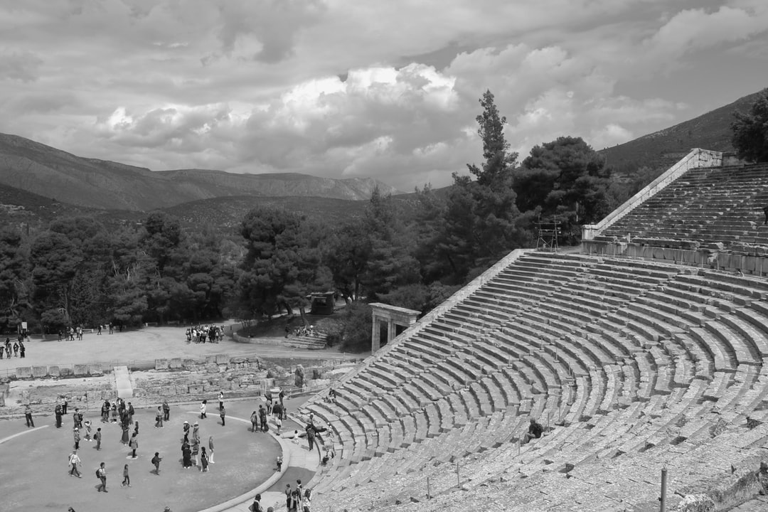 The ancient Epidauros theatre, built in the 4th century BC. Peloponnese, Greece. A great tourist attraction. Visitors on the stairs and on stage. South-east Europe.