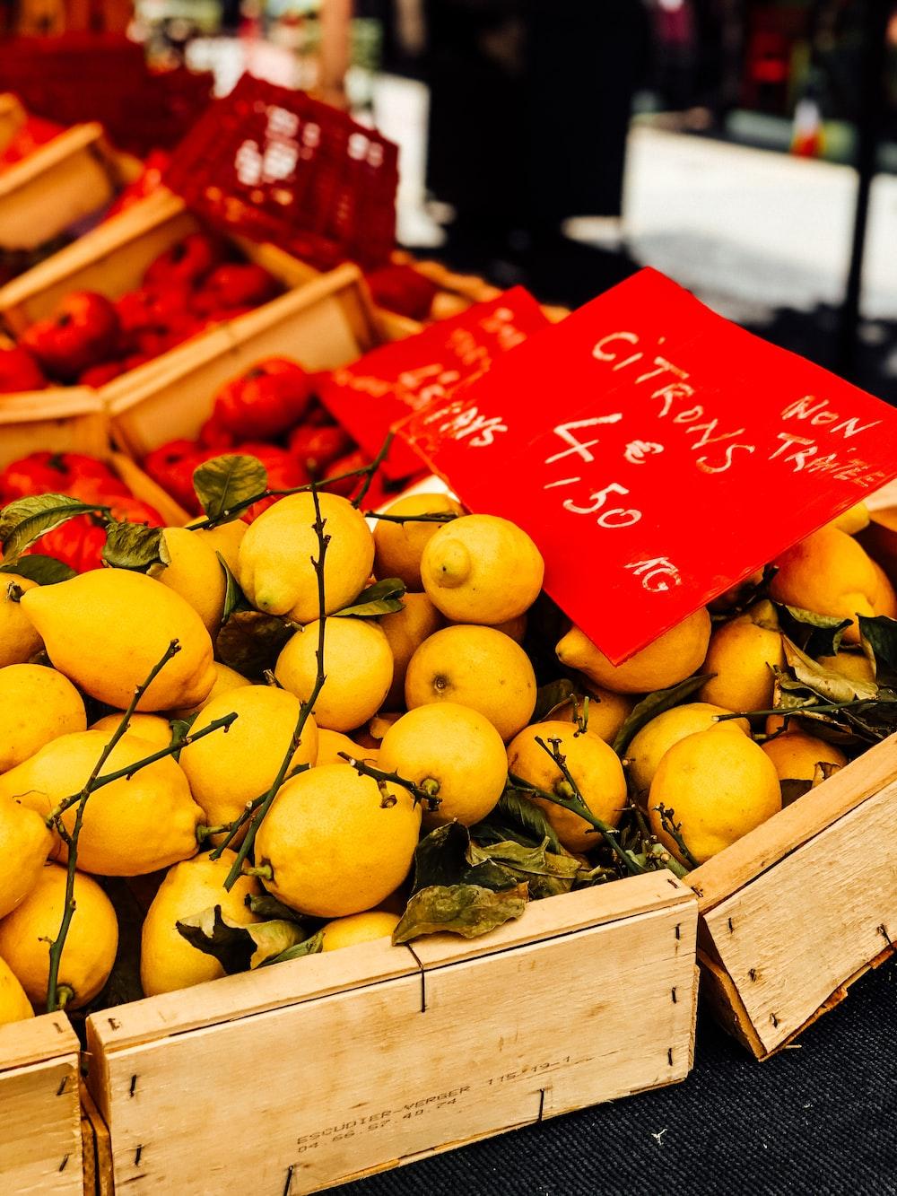 box of round yellow fruits