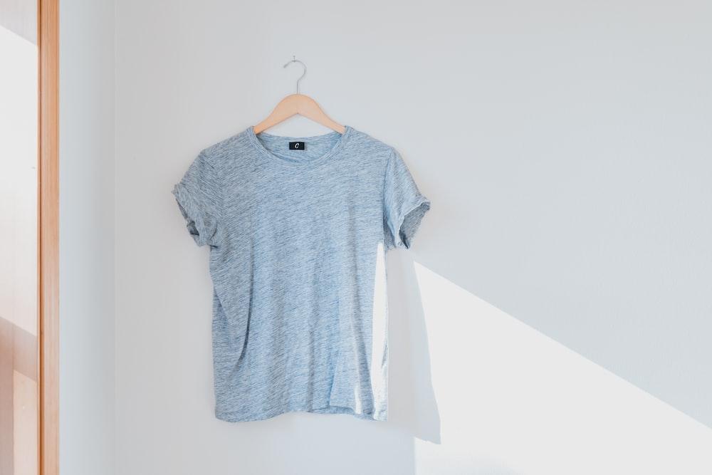 hanged grey shirt on white wall