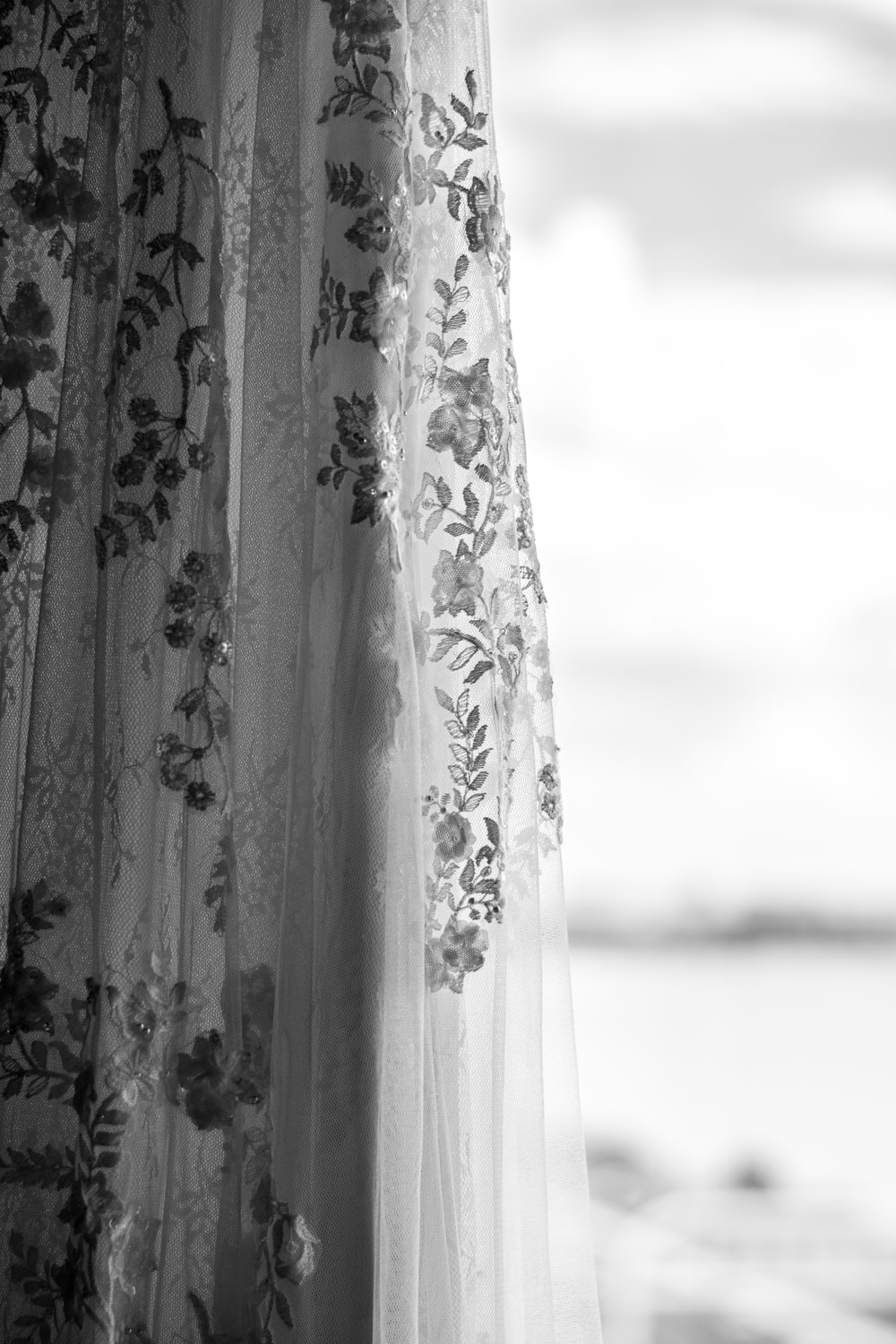 white and grey floral sheer curtain