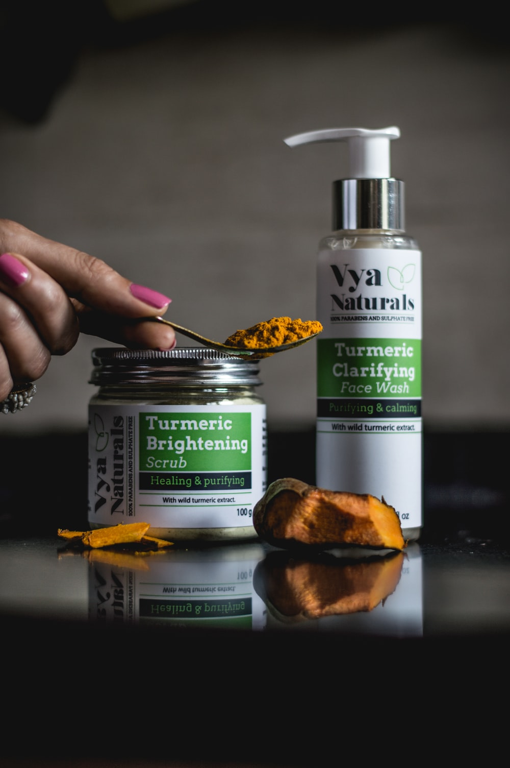 turmeric scrub jar and face wash pump bottle