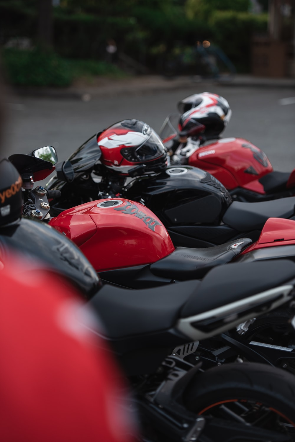three black-and-red motorcycles