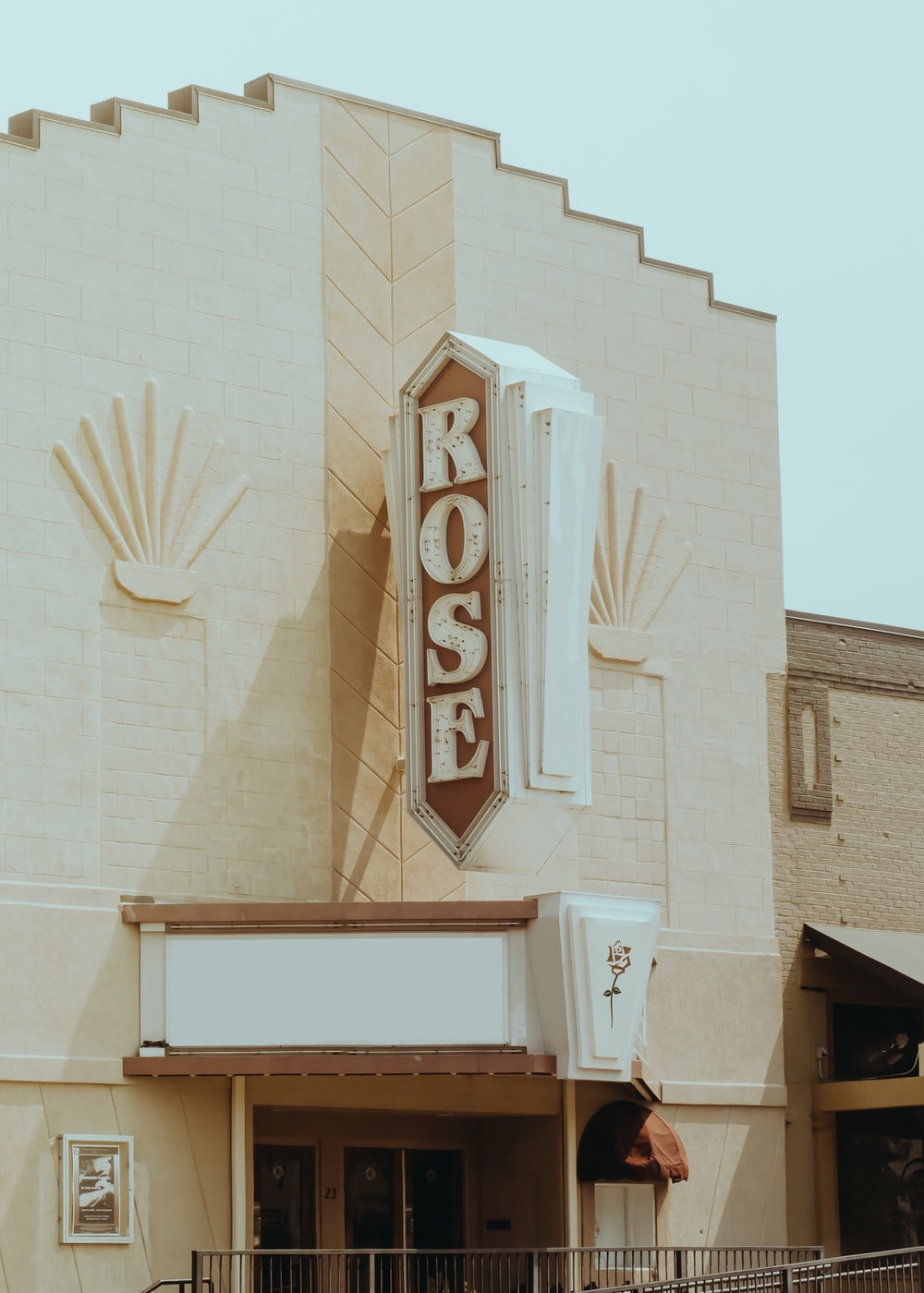 white and brown concrete Rose building