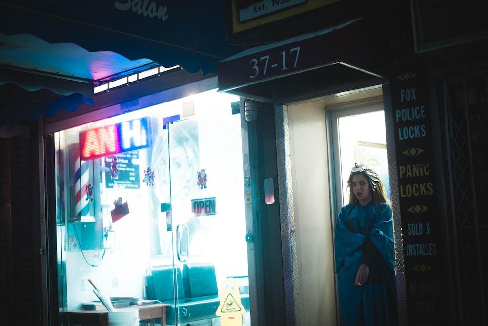 woman standing in door opened in room