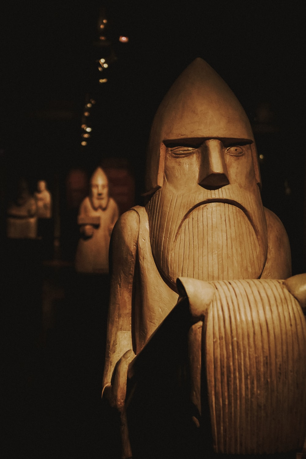 closeup photo of brown wooden statue