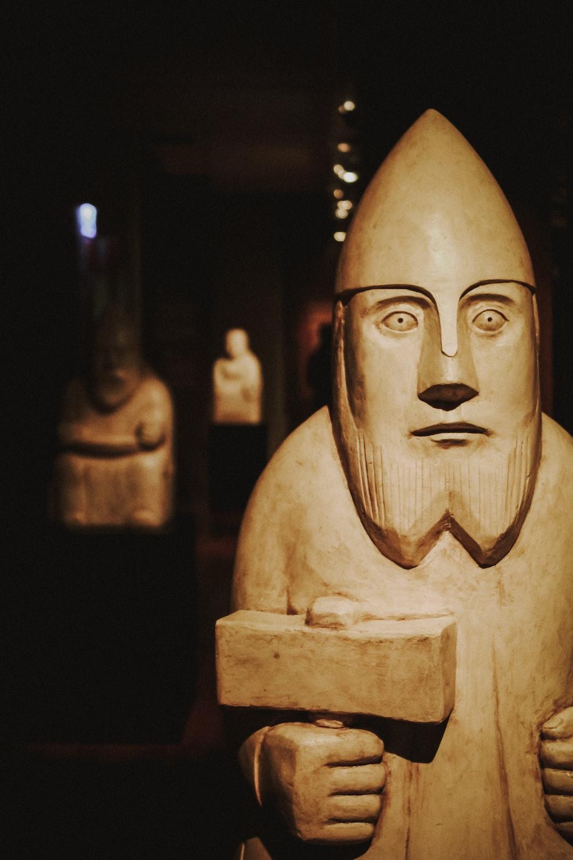 man holding hammer figurine