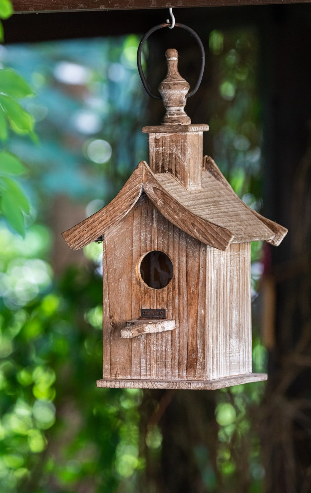 brown wooden birdhouse