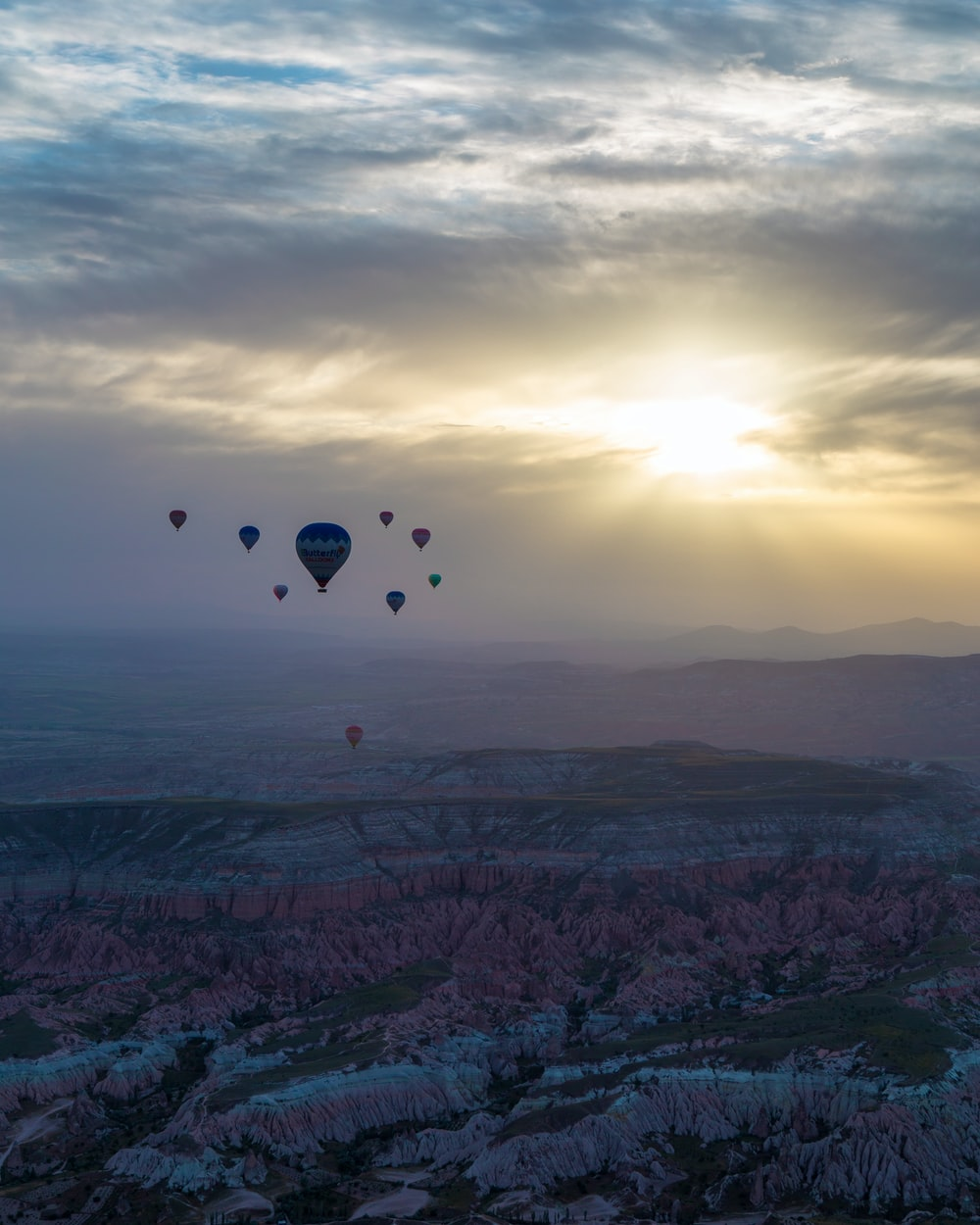 photography of floating hot air balloons during sunset