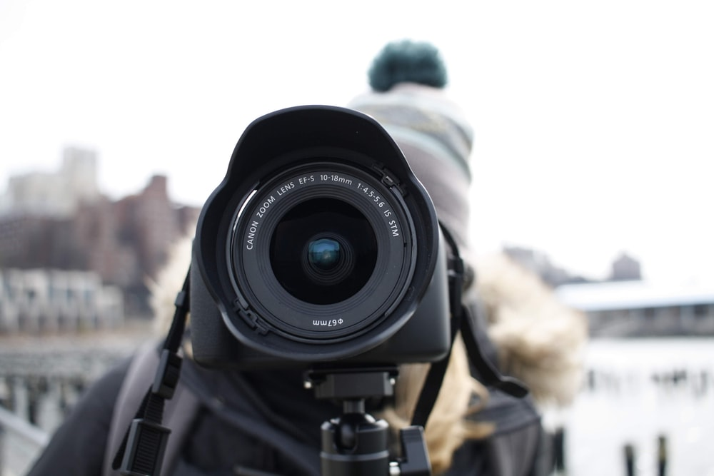 person using DSLR camera