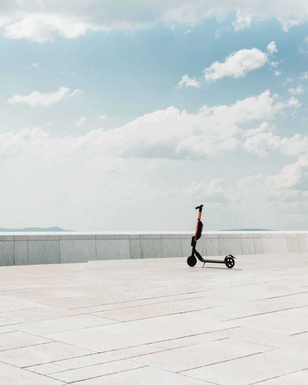 black kick scooter parked on concrete floor
