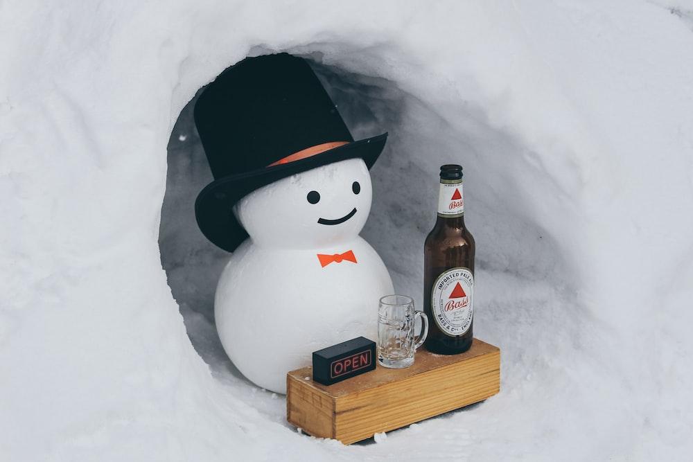 snowman beside bottle