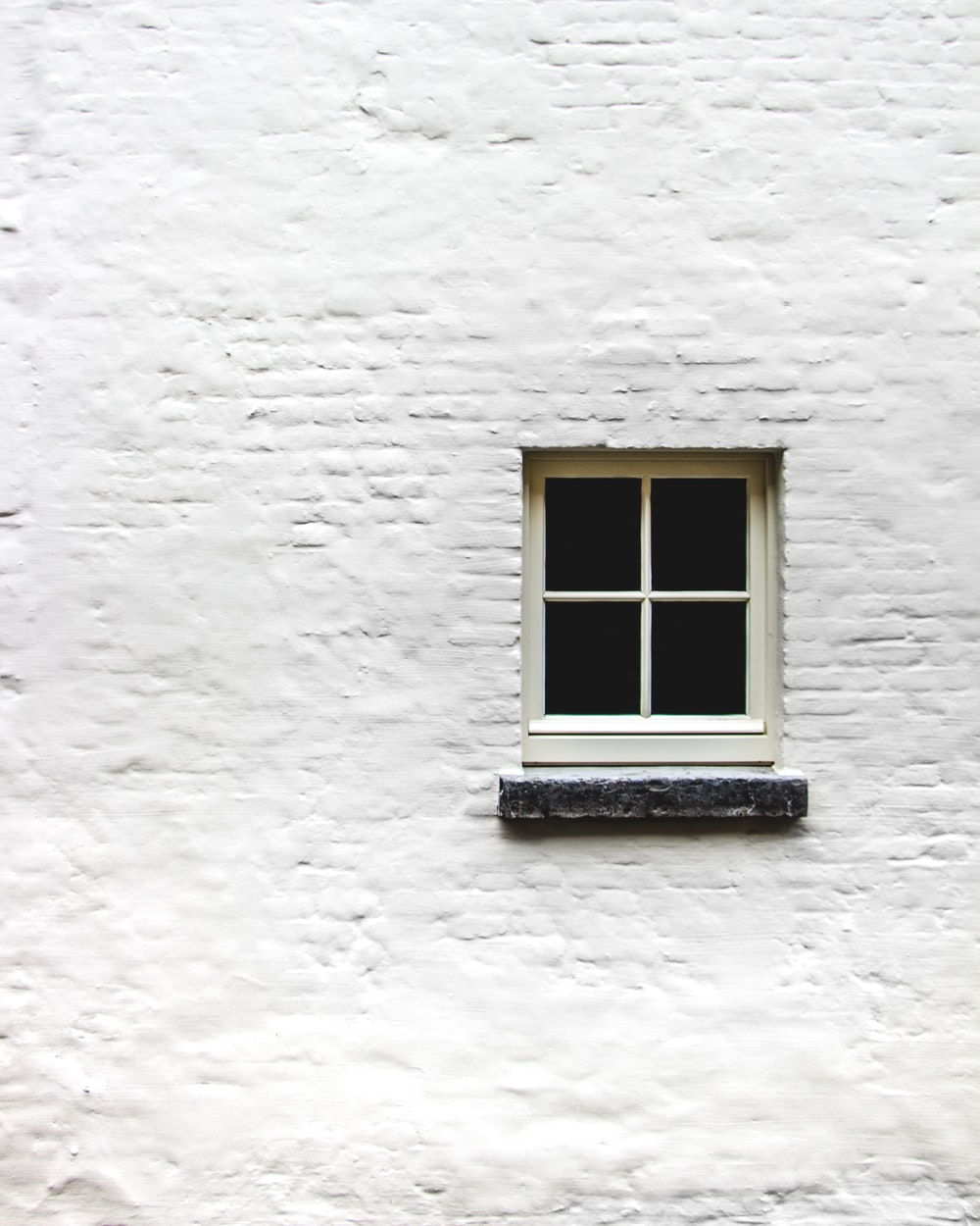 white wall with window close-up photography