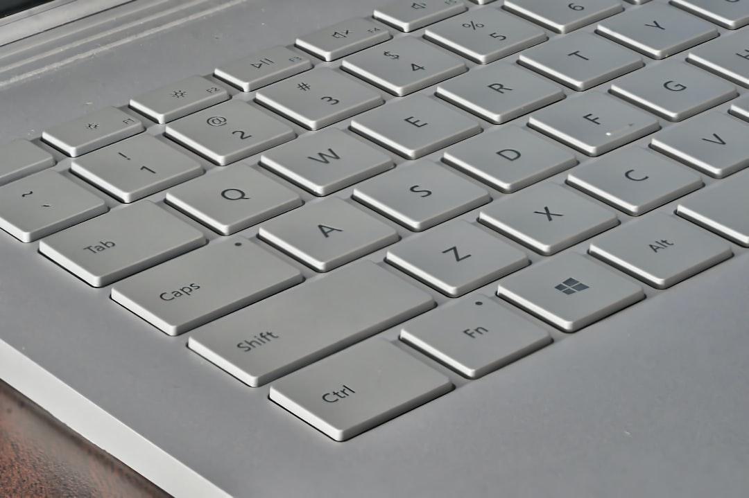 A close-up shot of a Microsoft Surface Book keyboard.