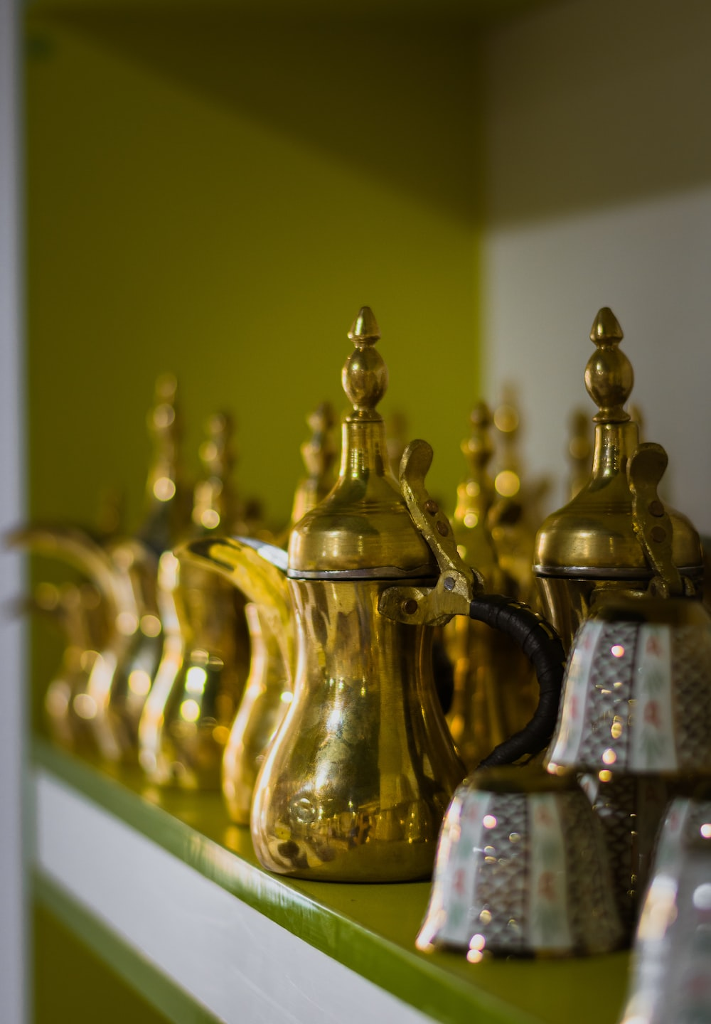 brass-colored teapot
