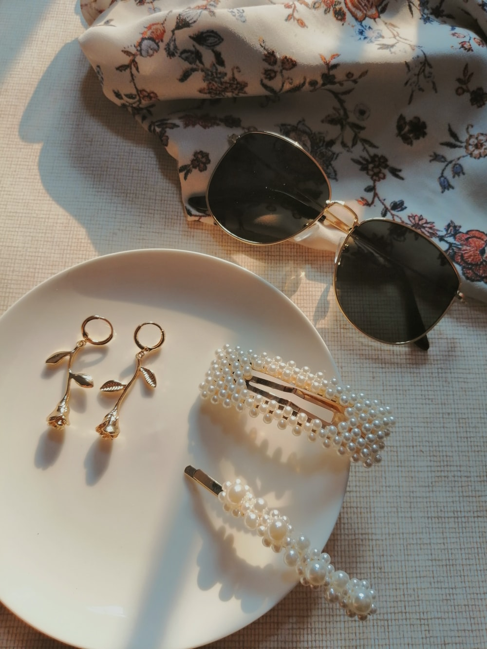 earrings and hair clip on plate