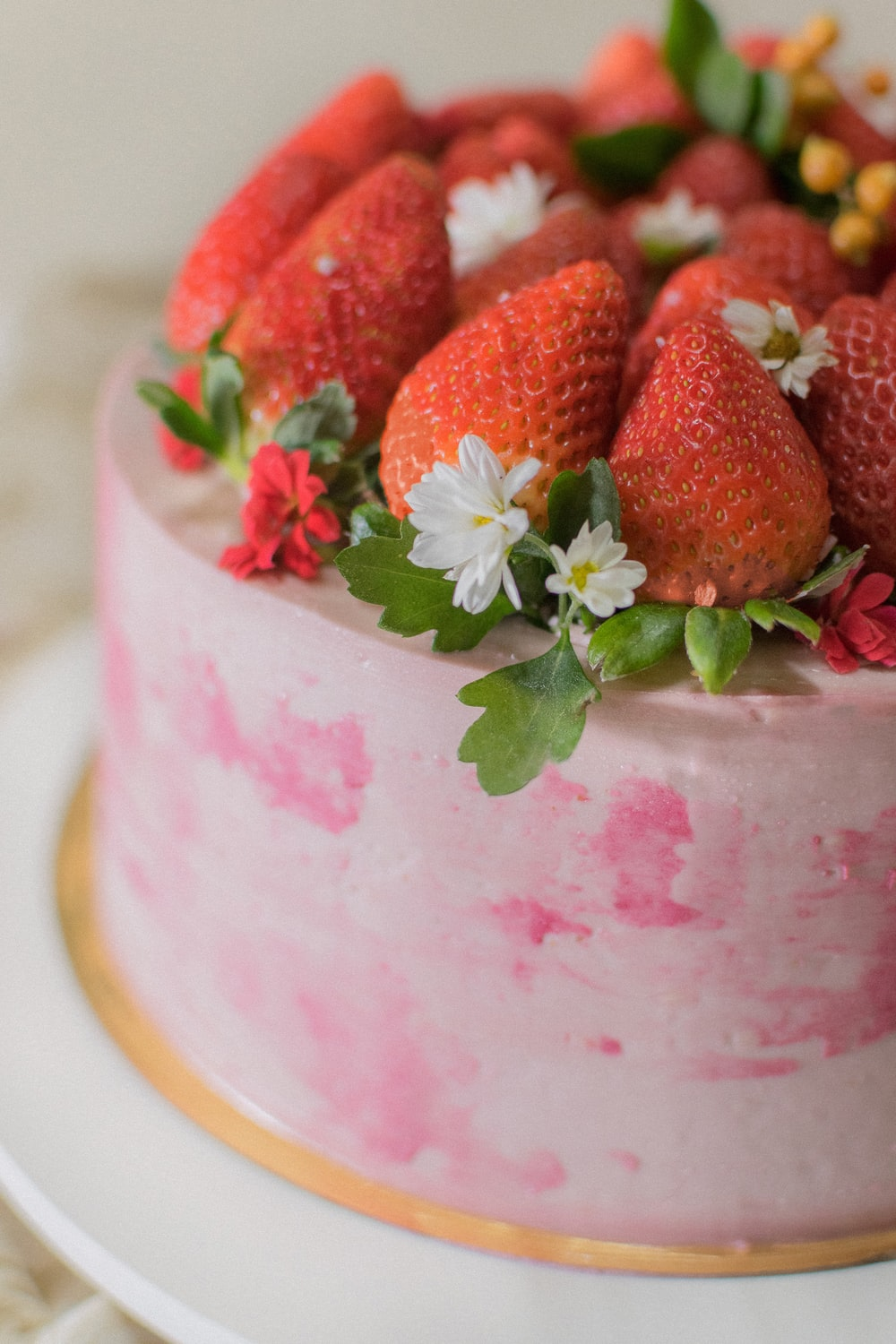 round cake with strawberries on top