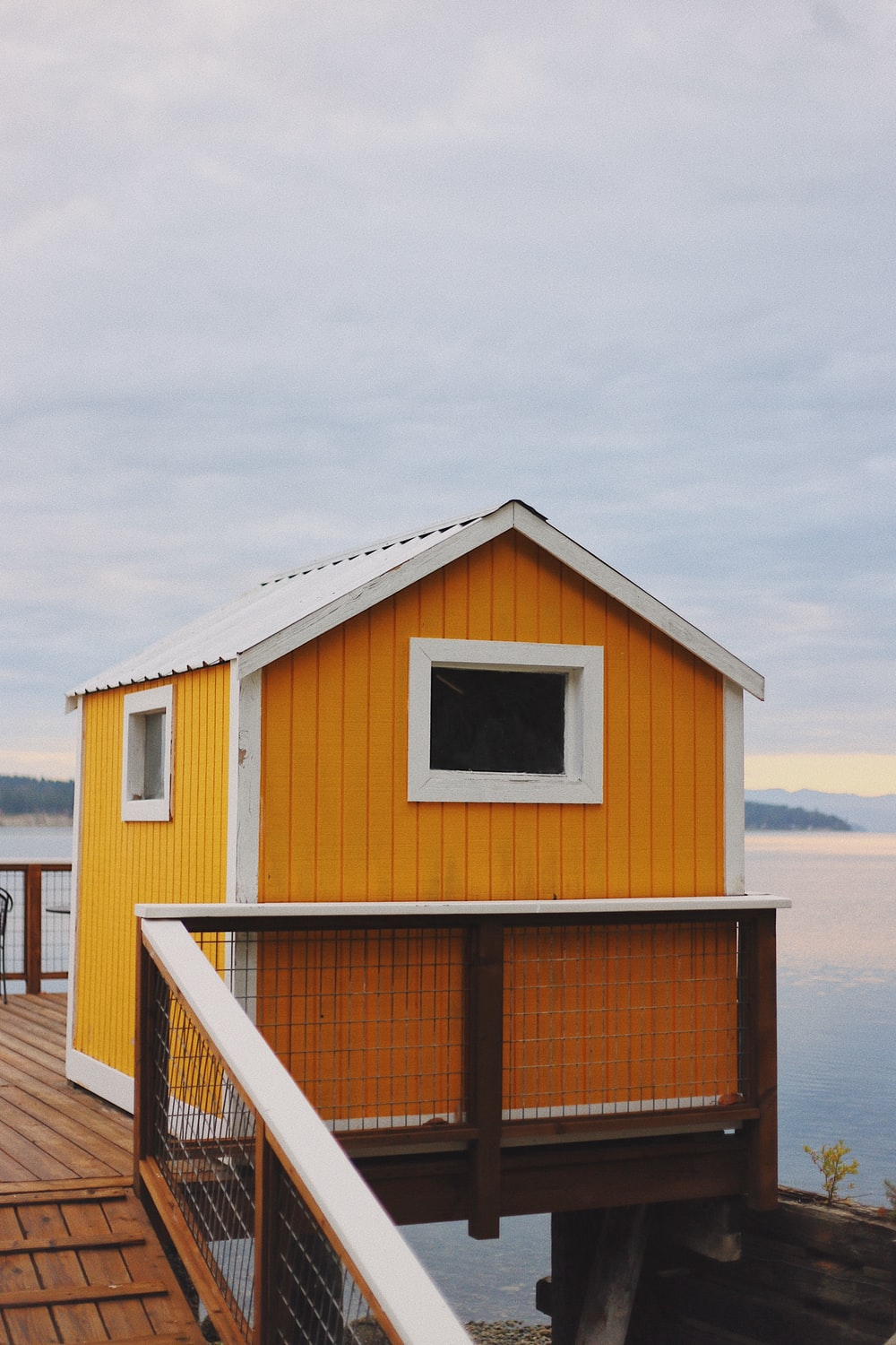 orange and white shed in dock
