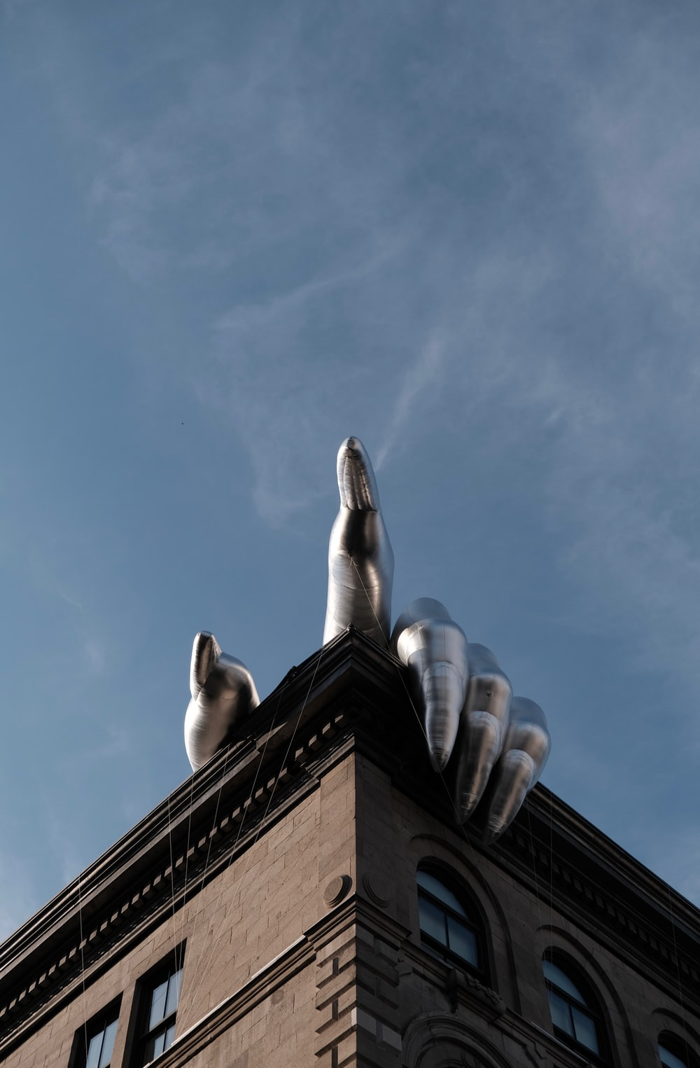 architectural photo of gray hand on brown building