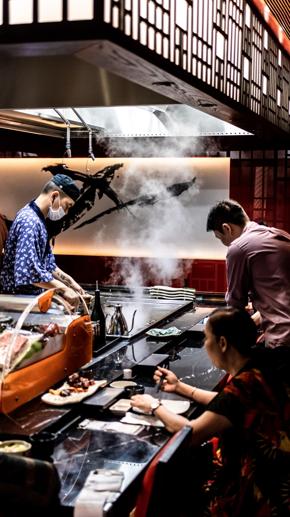 men and woman cooking