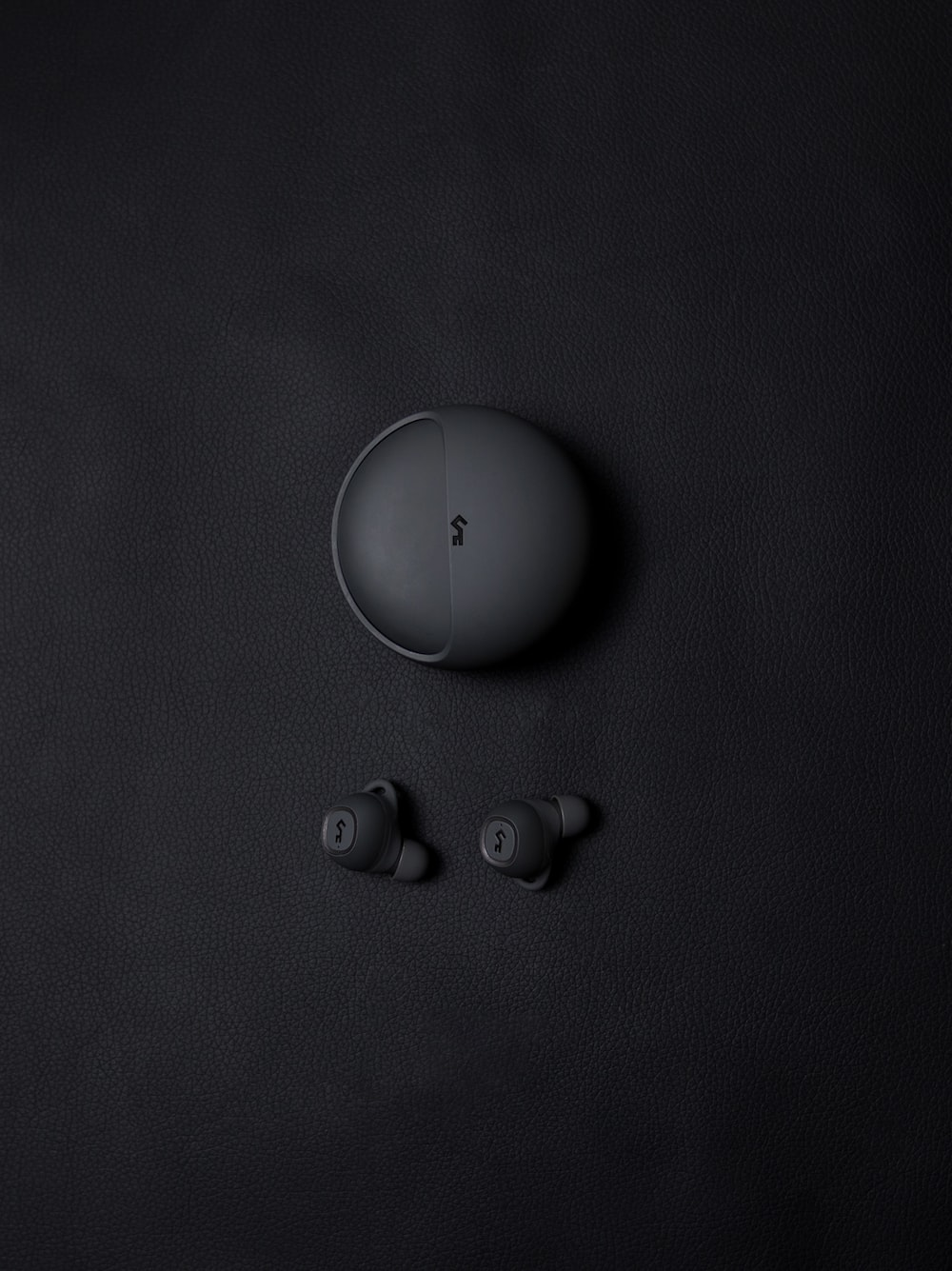 pair of gray headset with case