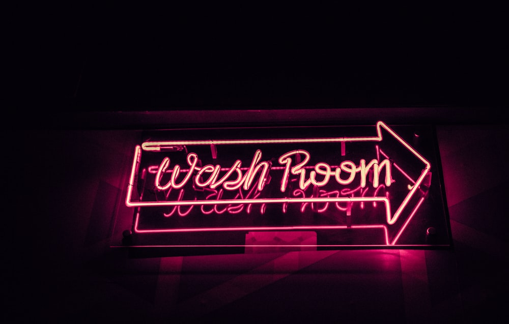 pink wash room neon signage