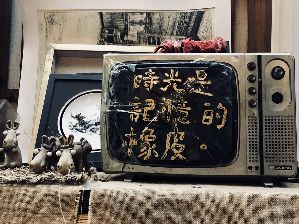 black and grey CRT TV