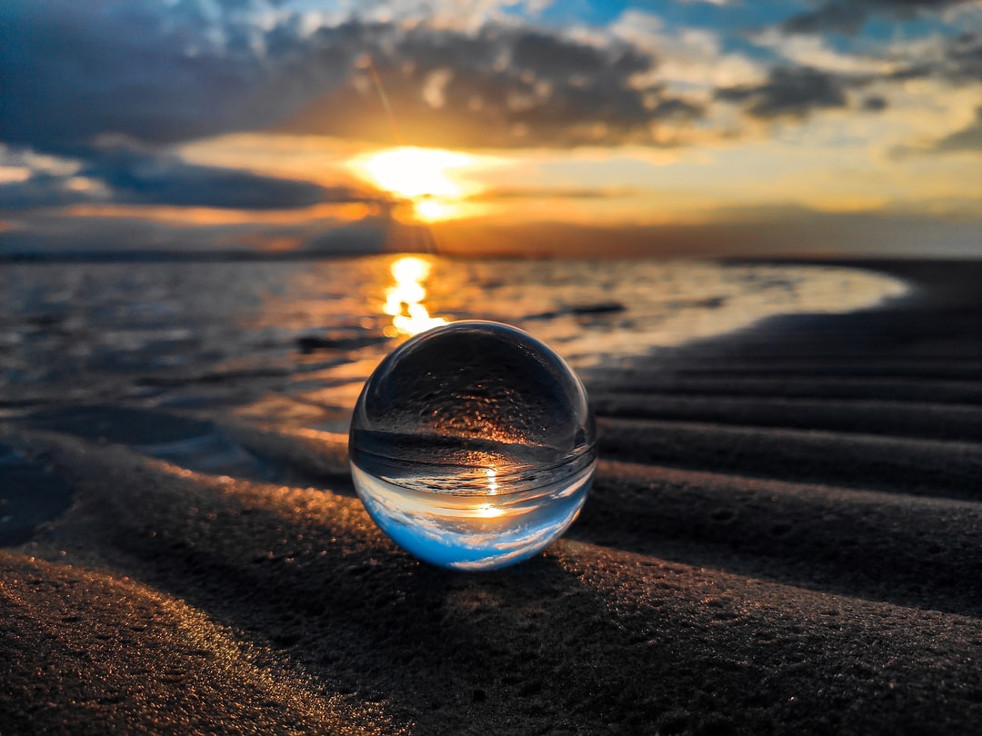 Lensball in Sand at the Baltic Sea at Sunset