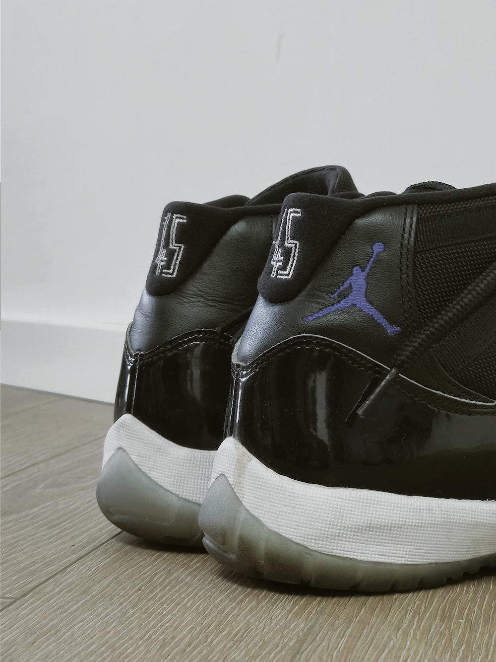 pair of black Air Jordan basketball shoes