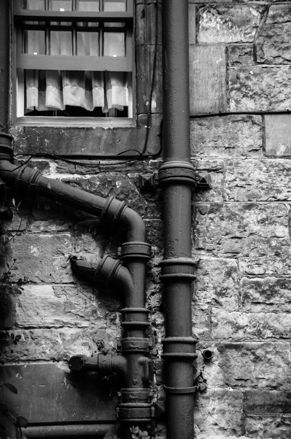 greyscale photography of pipe