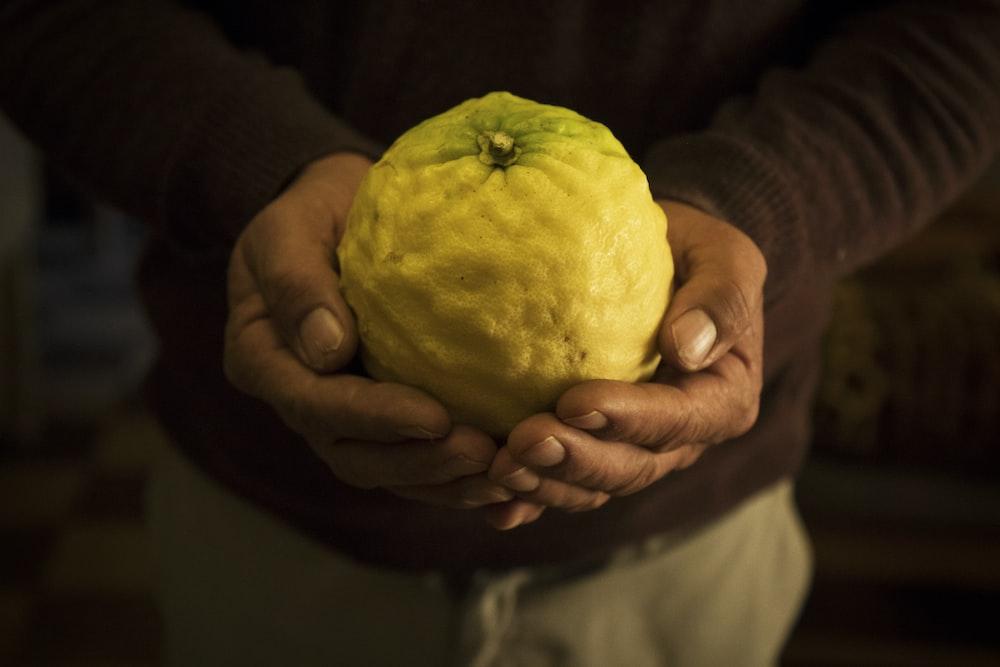 man holding a fruit