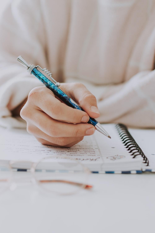 blue and black click pen