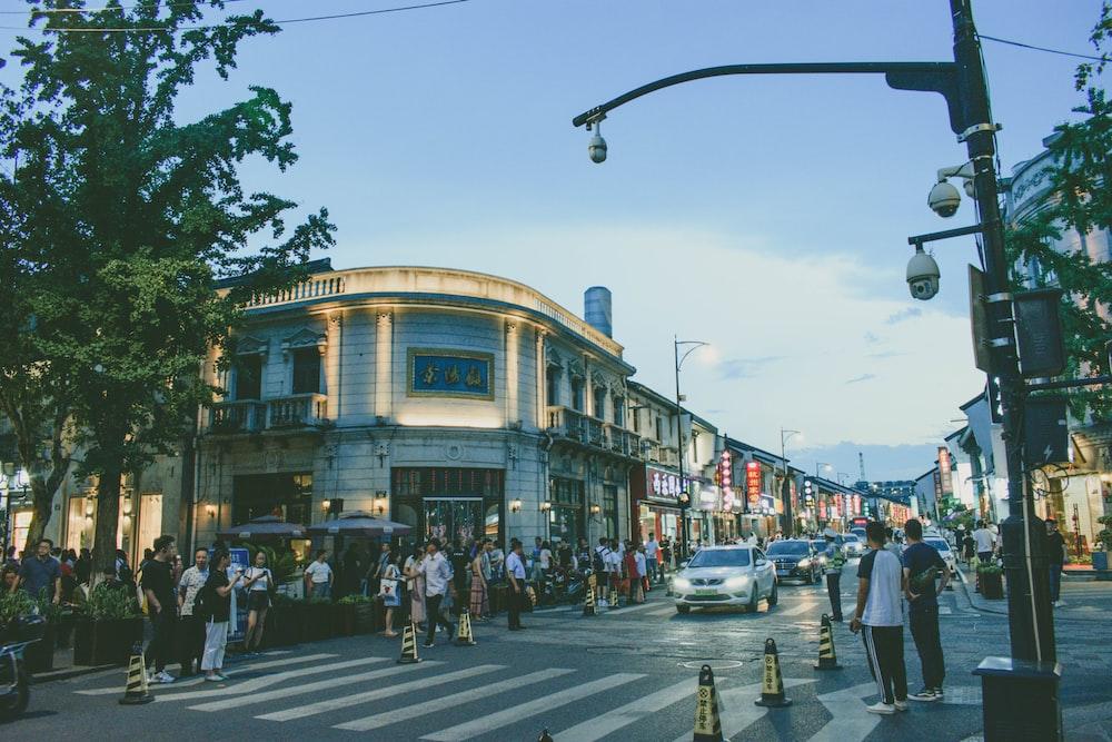 people walking near road beside buildings