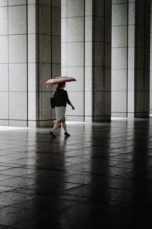 woman wearing black shirt and gray skirt