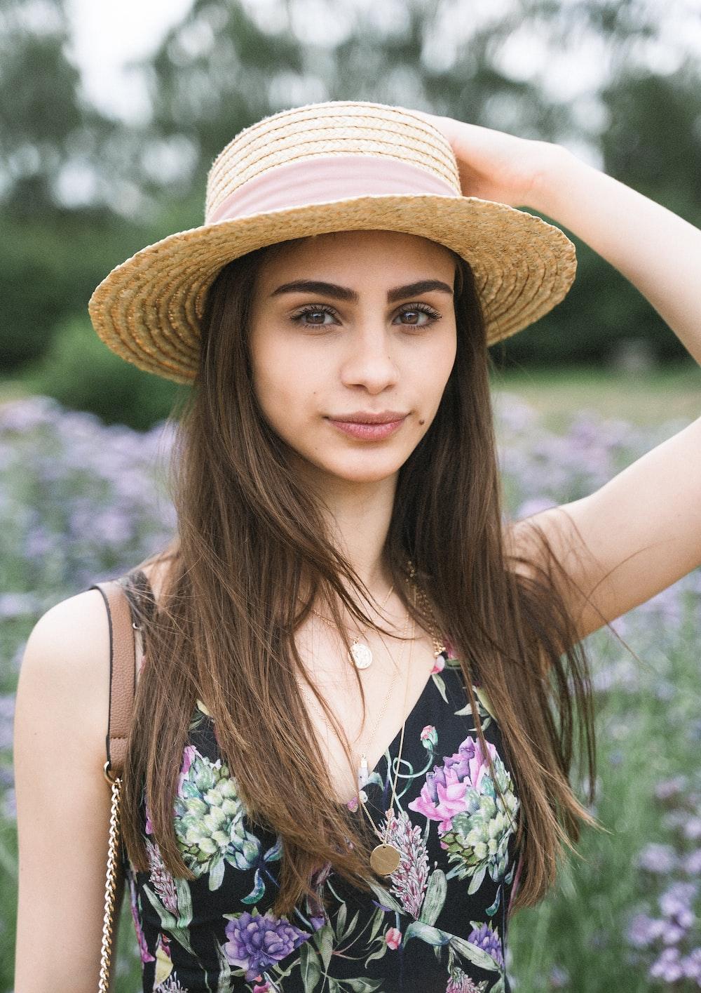 woman wearing beige strawhat