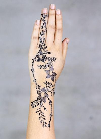 flowers hand tattoo