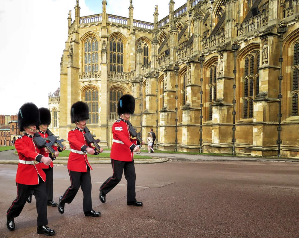 four Royal Guards marching outside palace