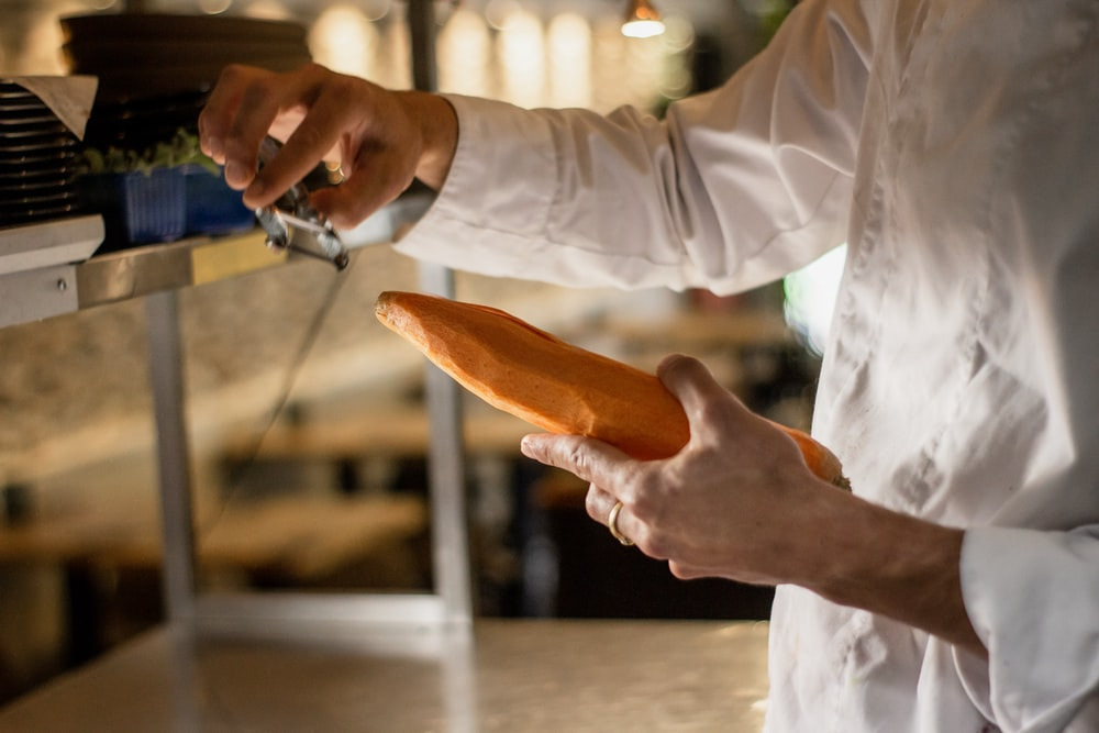 man holding carrot