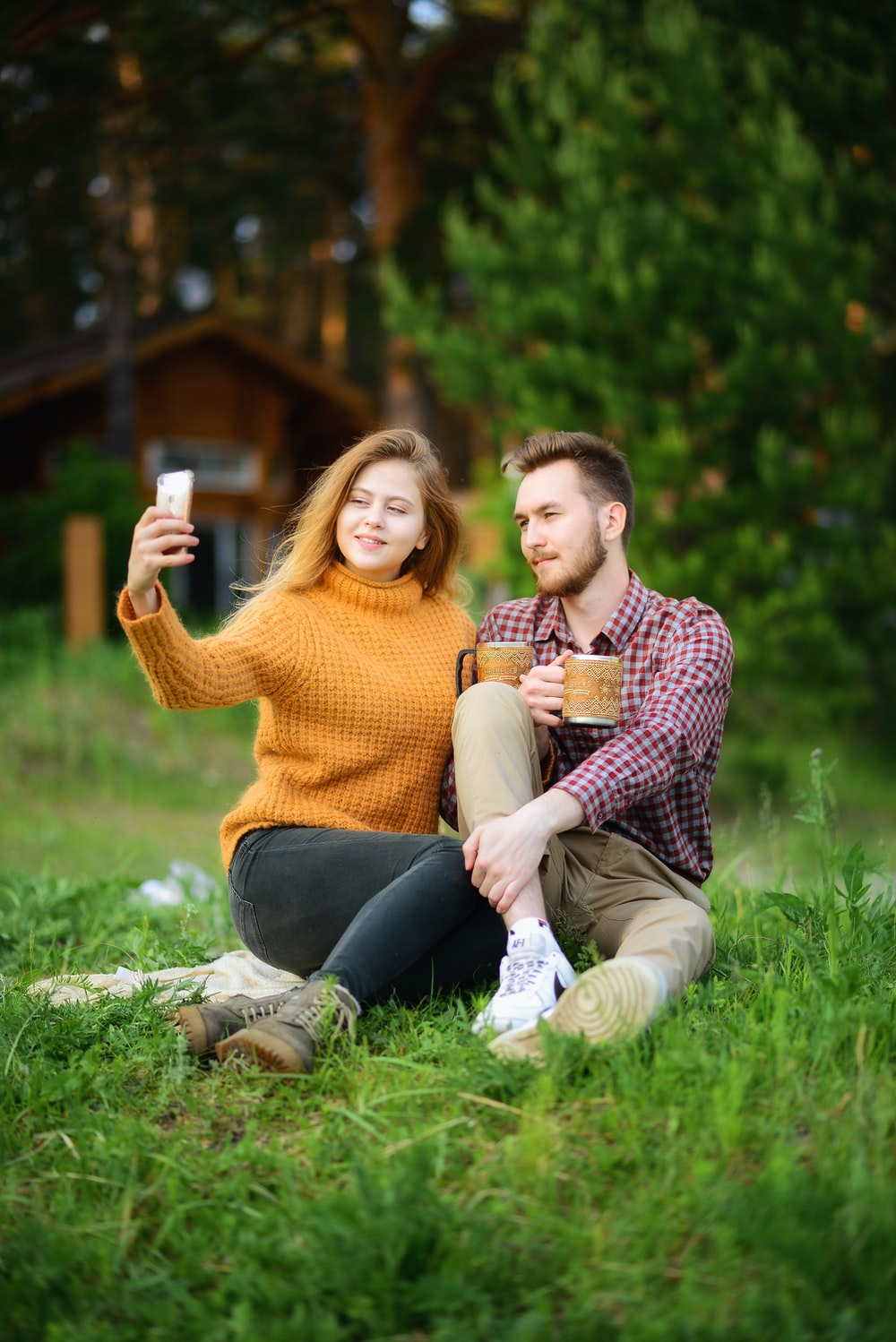 woman taking photo of man and woman