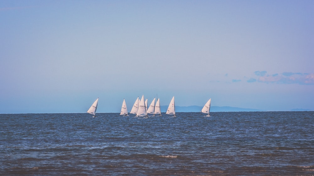 sail boats on ocean during daytime