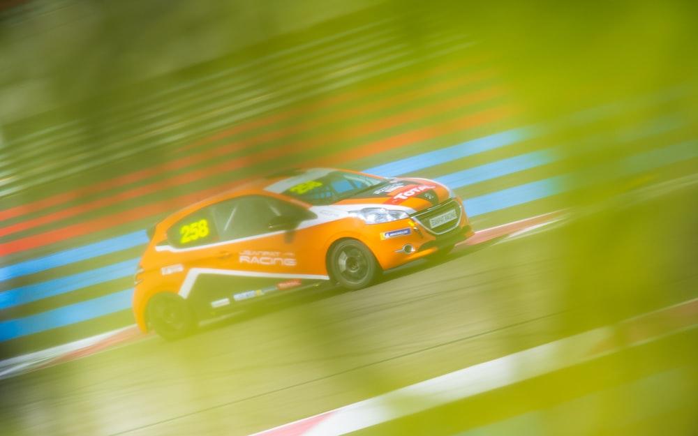 orange car on race track