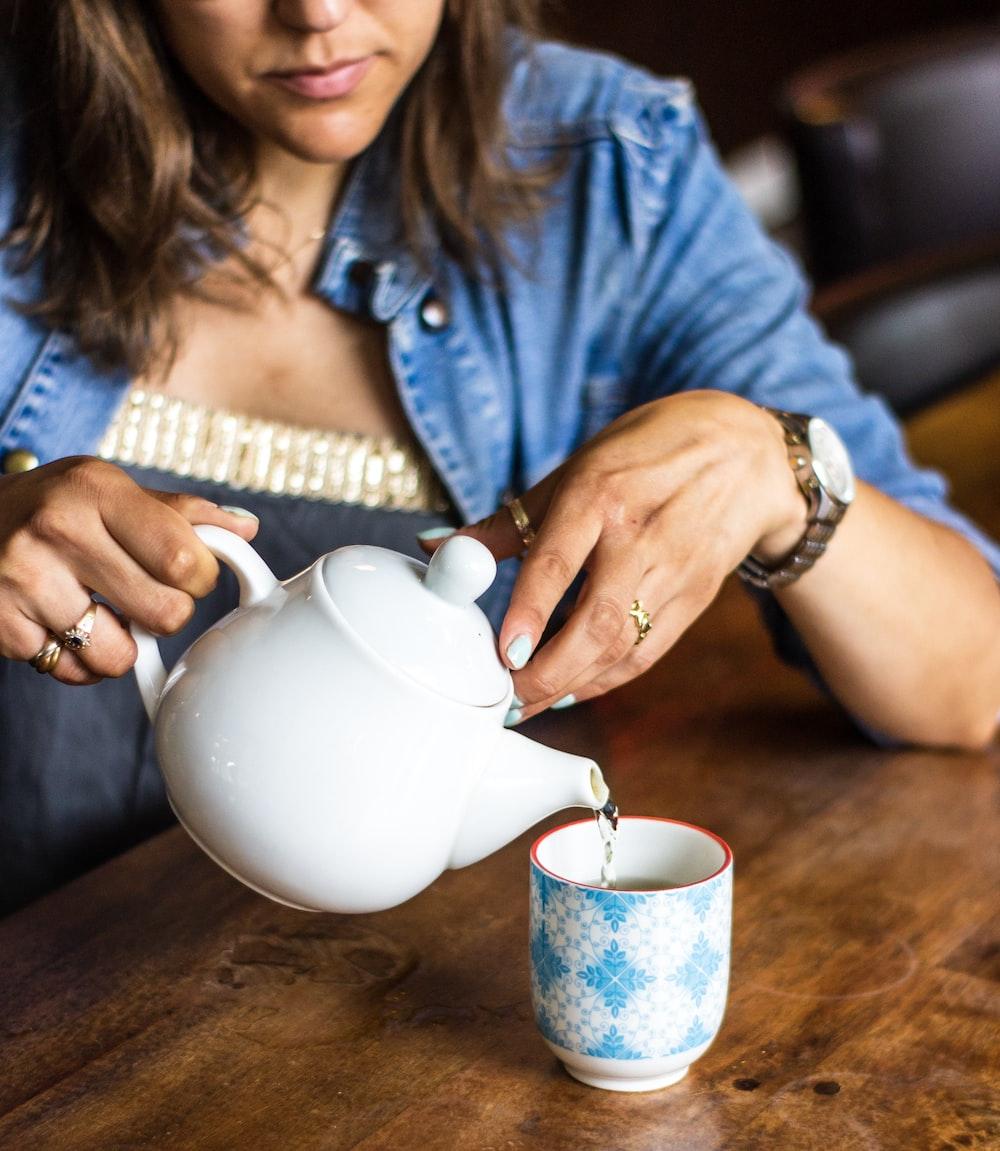 woman holding teapot