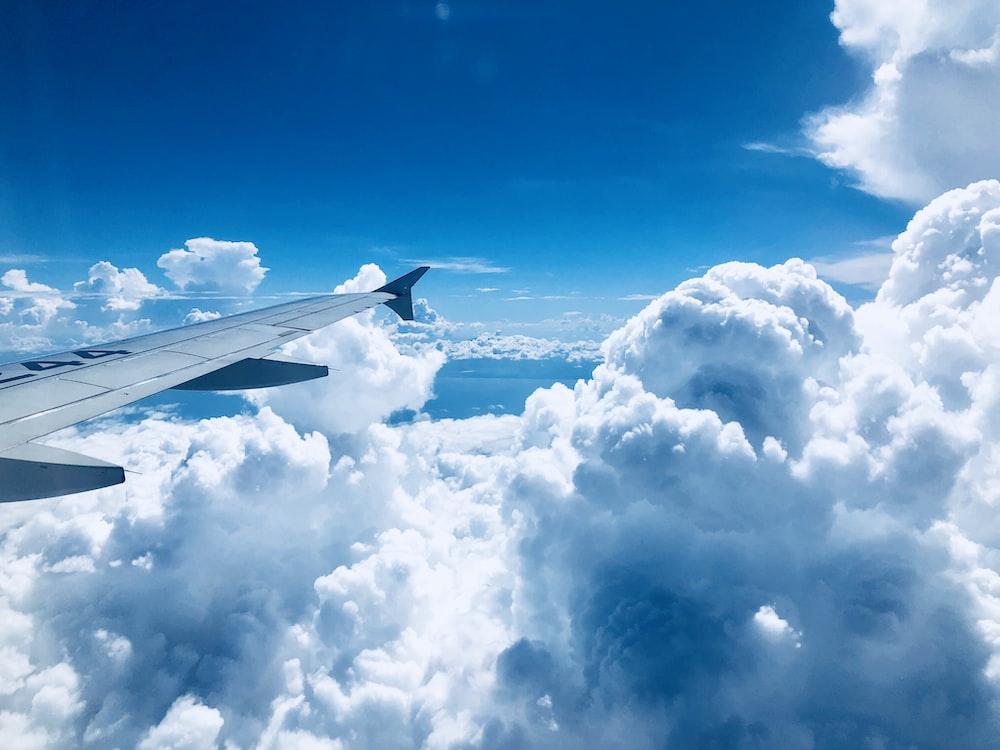 white airplane's wing at flight photo – Free Image on Unsplash