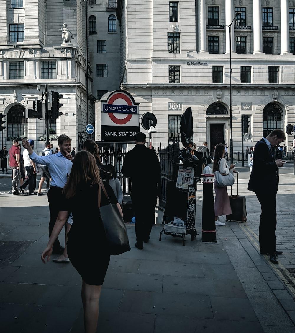 woman in black at a sidewalk