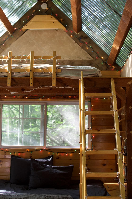 brown wooden loft bed frame