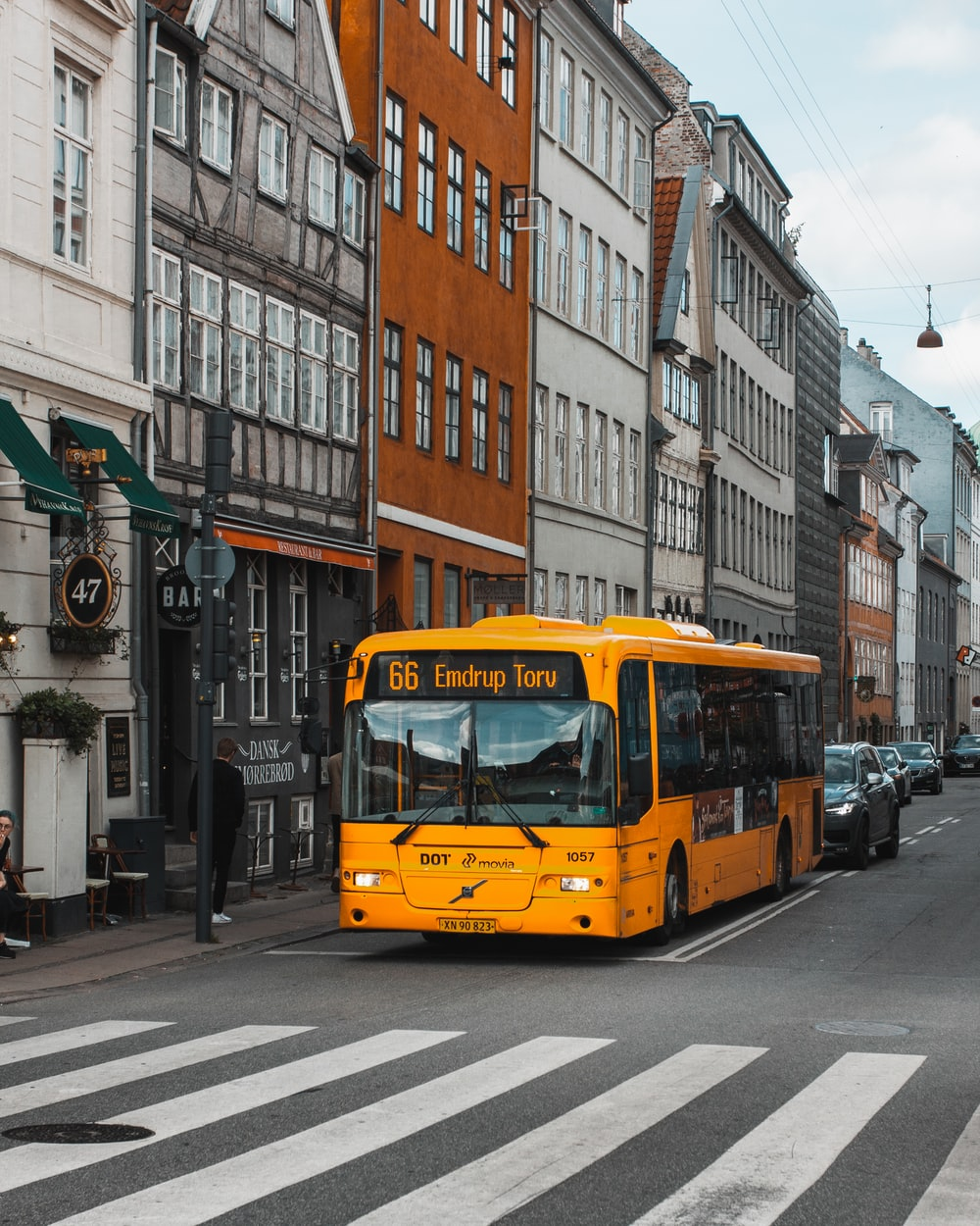 yellow and black bus on road at daytime