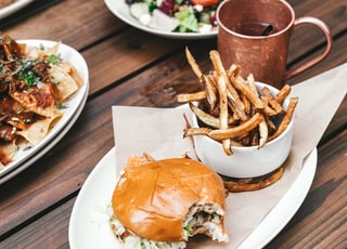 burgers and fries on oval plate