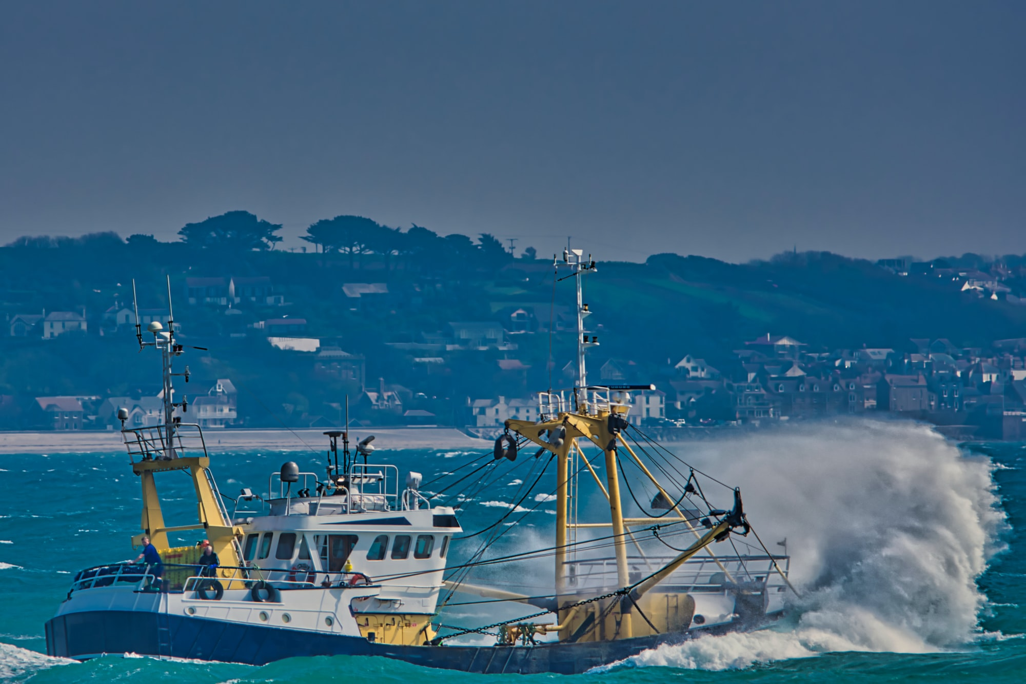 Trawler going to sea in rough weather.