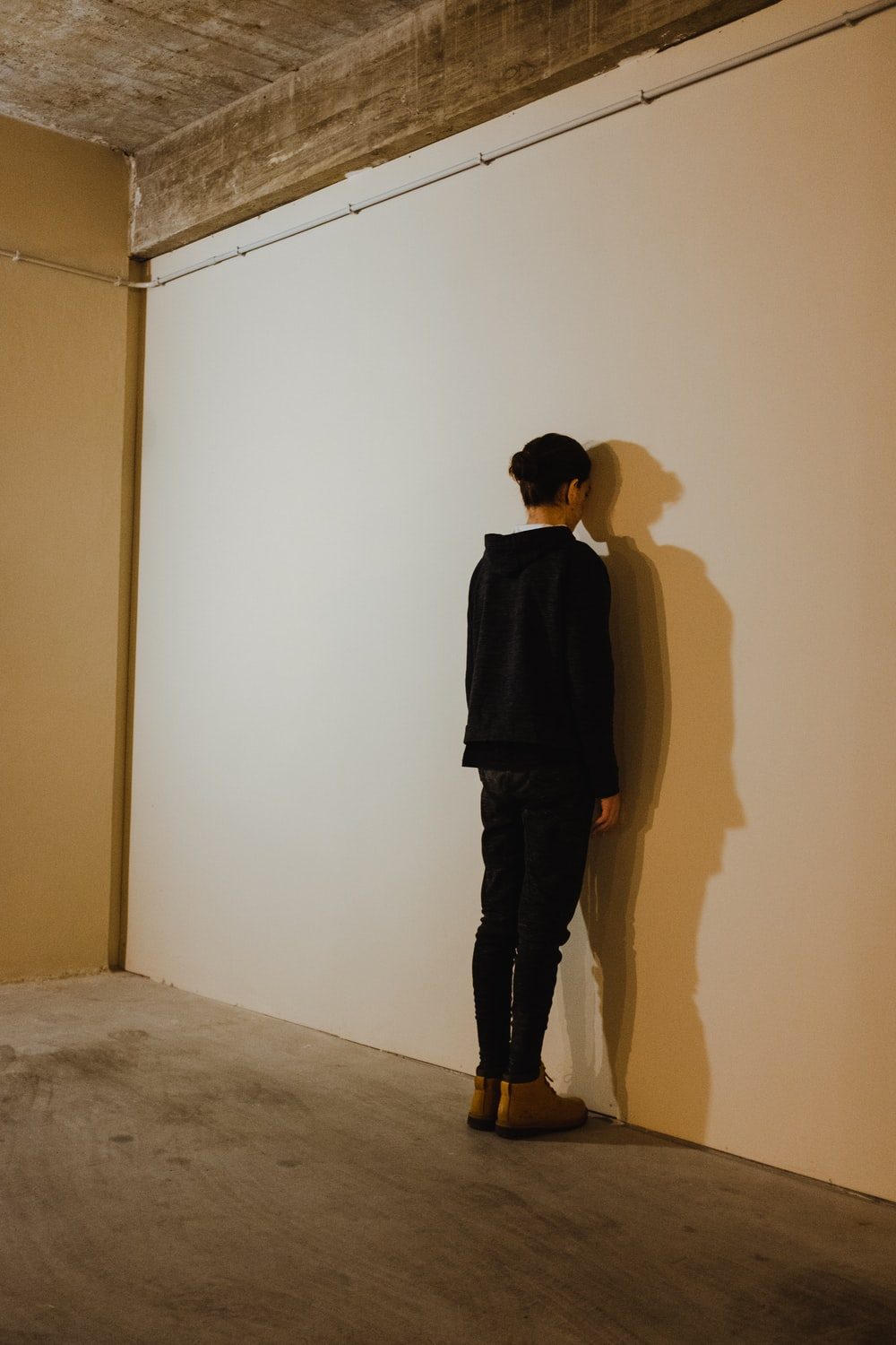 person standing beside wall